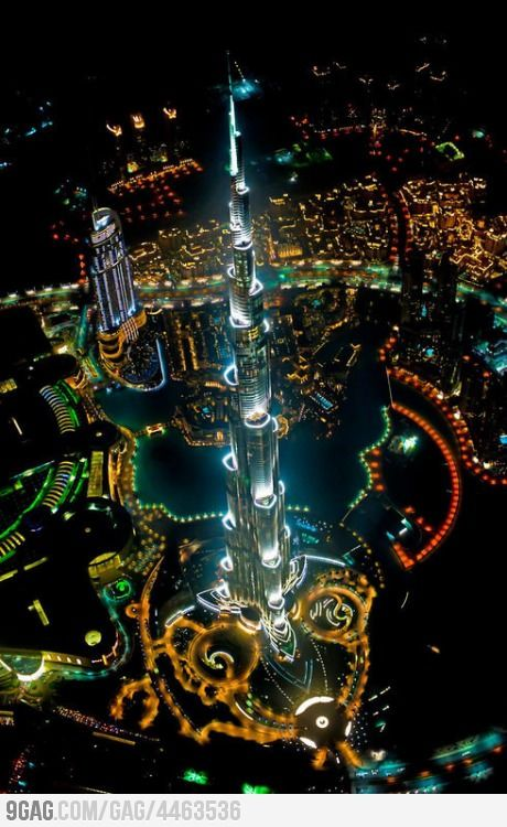 Tallest building in the world, from a helicopter, at night. The Burj Khalifa in Dubai. It's said you can see the sun set twice from different points in the building.