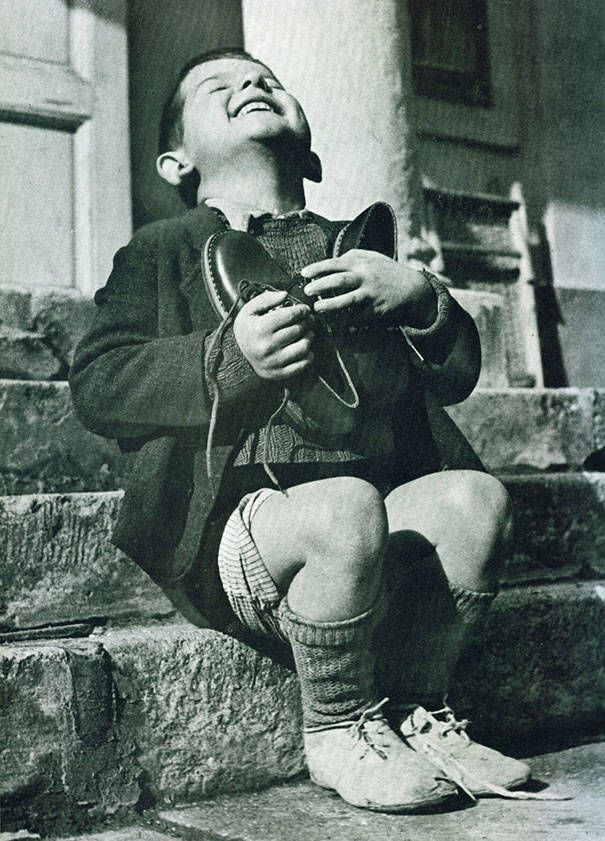 We forget all too quickly how simple items were luxury....This Austrian boy got a new pair of shoes in World War II.