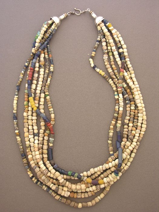 by Anne Holland   A simple seven-strand necklace with an ancient pedigree. Excavated in Mali, West Africa, are a selection of ancient granite, quartz, and glass beads, along with some antique beads from the same region.   Dorje Designs   625$
