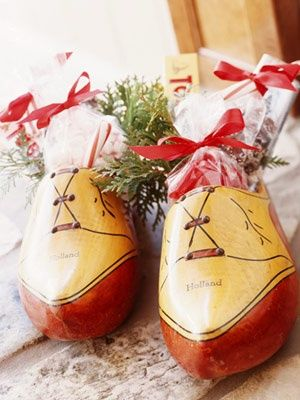 Wooden Shoes Filled With Candy In Holland december 5th is Saint Nicolas (Sinterklaas) day and an occasion for gift-giving. Sinterklaas is the one who gives the presents.