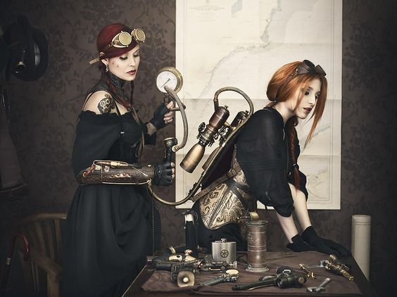 Steam Girls Fixing a Jetpack - For costume tutorials, clothing guide, fashion inspiration photo gallery, calendar of Steampunk events, & more, visit SteampunkFashionGuide.com