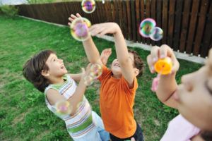 children playing with bubbles playdate