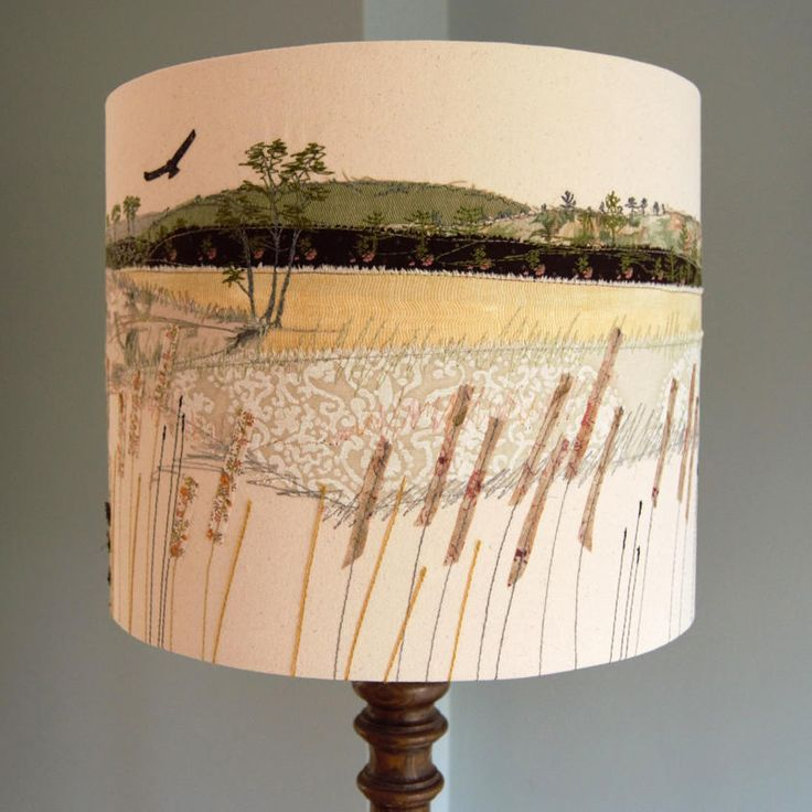 A lampshade is a beautiful way to display my original textile designs. I have made this lampshade using appliqué, free-motion embroidery and hand-dyed fabrics and wools. It is inspired by the popular countryside destination of Cannock Chase and produces a lovely glow when illuminated.This item is handmade and therefore one-of-a-kind.