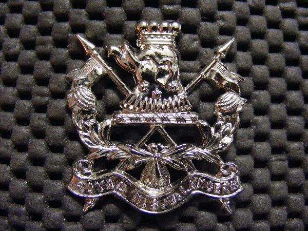 """The Regimental Badge of the Royal N.S.W. Lancers consists of an elephant's head with coronet and three fleur-de-lys on crossed lances with two waratah sprays and a scroll bearing the words """"Royal N.S.W. Lancers"""". The elephant's head is the crest of the late Lord Carrington who was Governor from 1885 to 1890. The crest is also the badge of the 16th Light Horse (M.G.) Regiment - The Hunter River Lancers."""