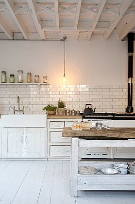 Gorgeous white kitchen. Love the subway tile backsplash. Nice and crisp and clean and beachy.