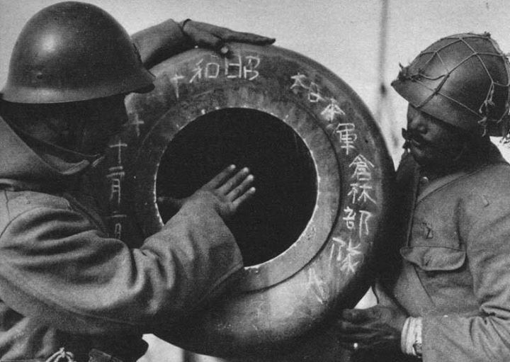 """2nd December 1937 - A pair of Japanese soldiers with an  item labeled """"Japanese Army Kurabayashi Detachment"""" Nanjing China"""