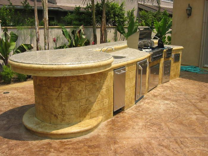 Custom outdoor kitchen with concrete bar top complements for Outdoor bar top ideas