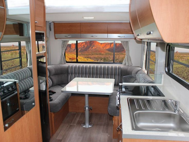 This is the C7184 Ceduna motorhome. The dinette is at the rear of the motorhome, and there is an electric roll down bed, currently positioned above it which comes down as the main sleeping area at the press of a button.
