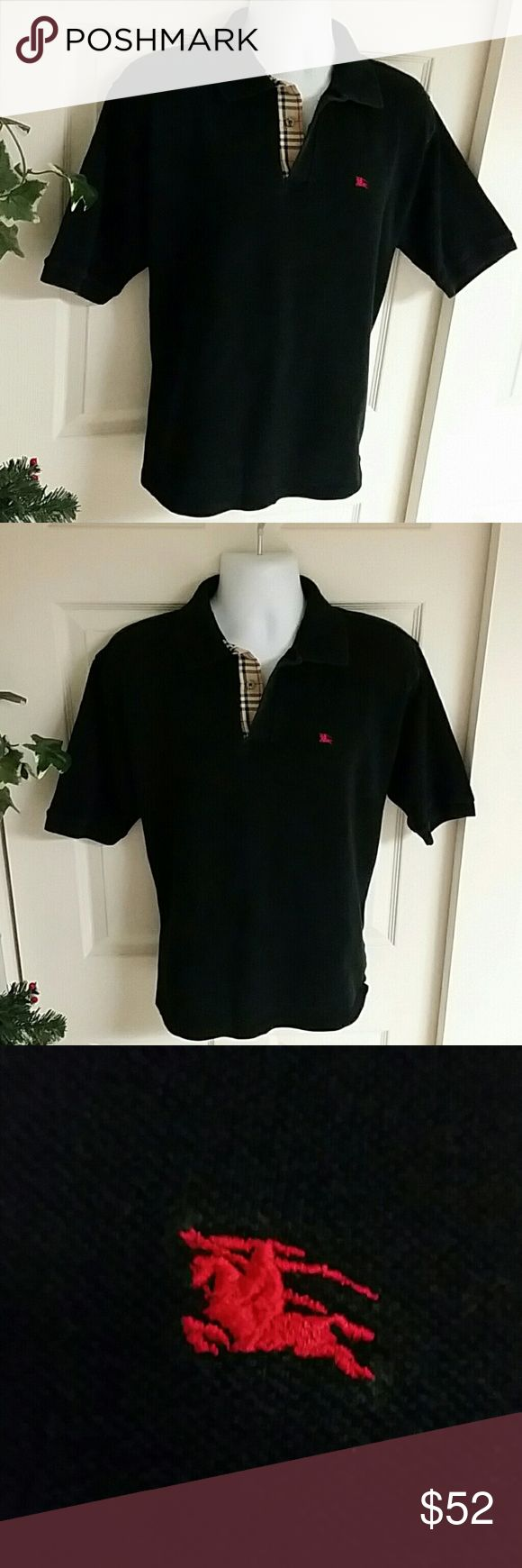 Burberry Polo Shirt Black elegant Burberry Polo shirt.  100% Cotton.  Great condition.   Made in England. Comes with extra Burberry button Burberry Shirts Polos