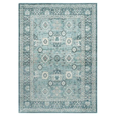 Stylishly anchor your living room seating group or define space in the den with this artfully crafted rug, showcasing a Persian-inspired motif in alpine.
