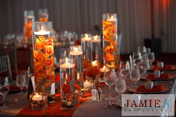 Submerged purple flowers with floating candles, cymbidium orchid stems, clusters of gerber daisies and protea, Jamie K Photography New York, A Touch of Elegance Floral & Event Design