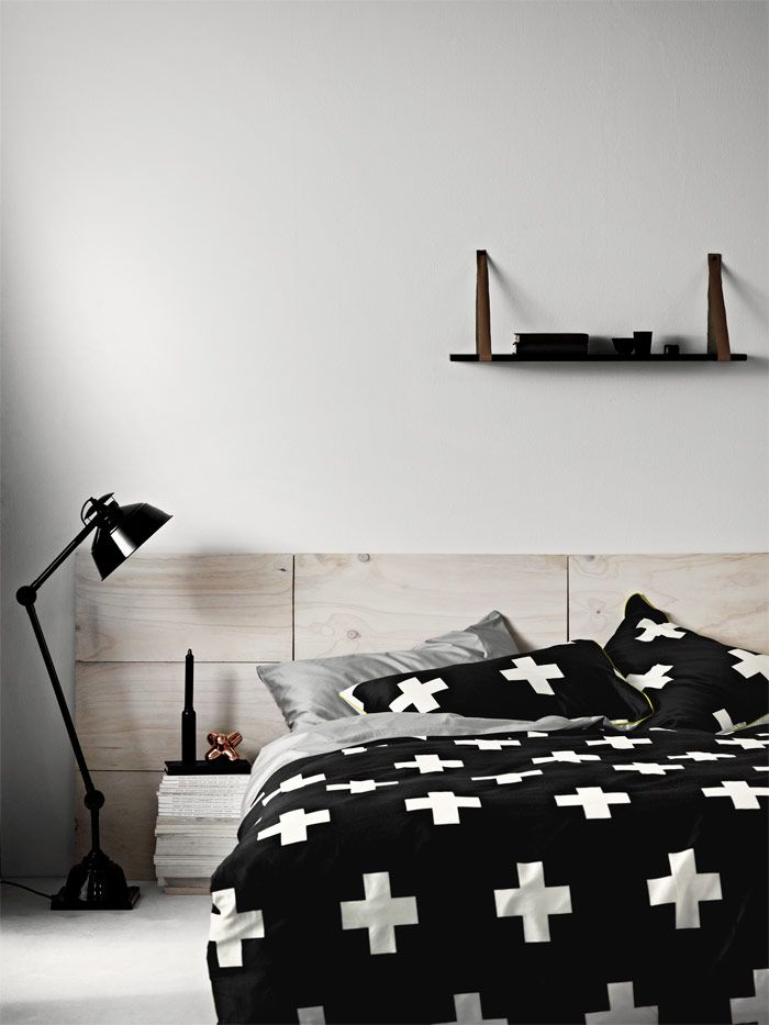 Striking graphic bedroom with whitewashed wood headboard and Crosses Quilt Cover by @aurahome.