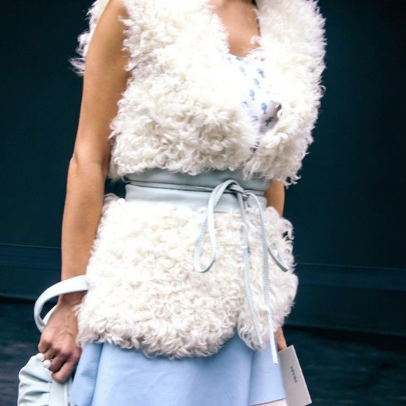 Street Style Details of Milan Fashion Week - fur gilet in the hot weather
