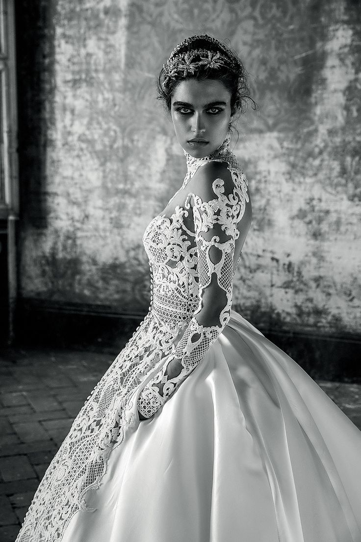 A stunning illusion high necked wedding gown with sheer embroidered bodice and sleeves with luxurious train // We've been fans of J'Aton's heavily embellished dresses ever since we saw celebrity Rebecca Judd's wedding dress years ago, so when we heard about the Australian couture brand's Bride collection – a collaboration with established Italian bridal house Valentini Spose – we had to find out more