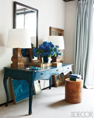"peacock blue table rocks.   ""In this bedroom, we used blue in the form of a beautifully painted French provincial desk, paired with blue works of art, pale-blue curtains, and loads of blue hydrangeas,"" says Carrier, pointing out that wall paint isn't the only way to bring color into a room. ""A wonderful way to introduce blue into a room is through art.""   Photographer: William Waldron"