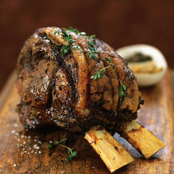 A thyme-roasted rib of beef recipe with red wine gravy. Garnish with extra thyme. Delicious Magazine