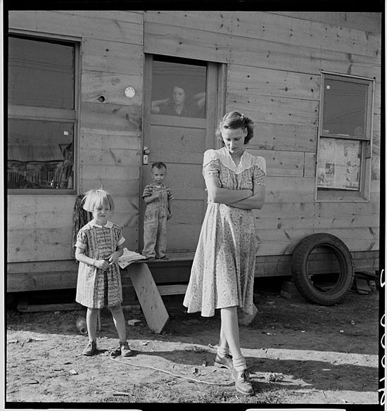 Depression-era mother worries for her children. Photo taken by Dorothea Lange.