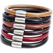 men stacking bracelets