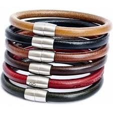 men stacking bracelets