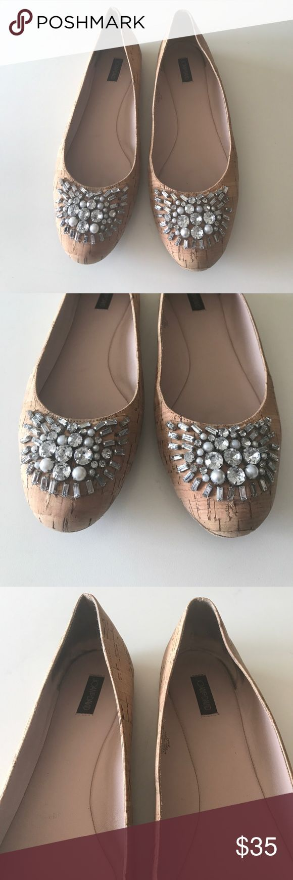 Joan & David Joan & David cork flats. Size is 8 1/2. Very good used condition. No heel at all. Comes with box. Is a very cute piece to wear with slacks or a skirt. The diamond front gives it a very classy look. Cute baby pink inner sole. Joan & David Shoes Flats & Loafers