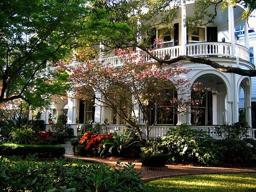Southern style antebellum home with wrap around two story for Two story house with wrap around porch