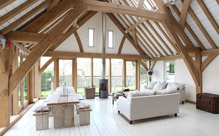 Barn room extension with exposed green oak frame in Oxfordshire by Roderick James Architects