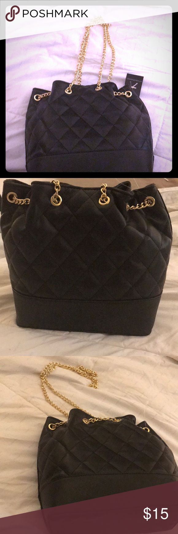 Quilted Bucket Bag Black and Gold Chanel inspired quilted bucket bag. Medium sized bag. Leather like material. New with tags. Message for more details or pictures. Can be worn on shoulder or crossbody. Bags Shoulder Bags