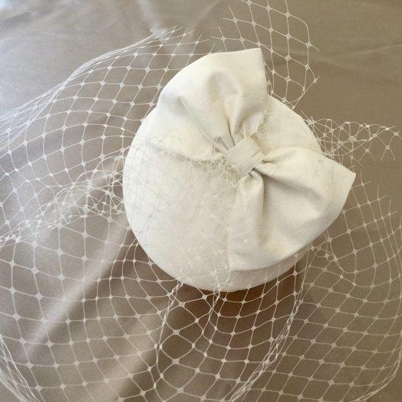 Handmade ivory bridal wedding cocktail hat, fascinator, bow, veil.