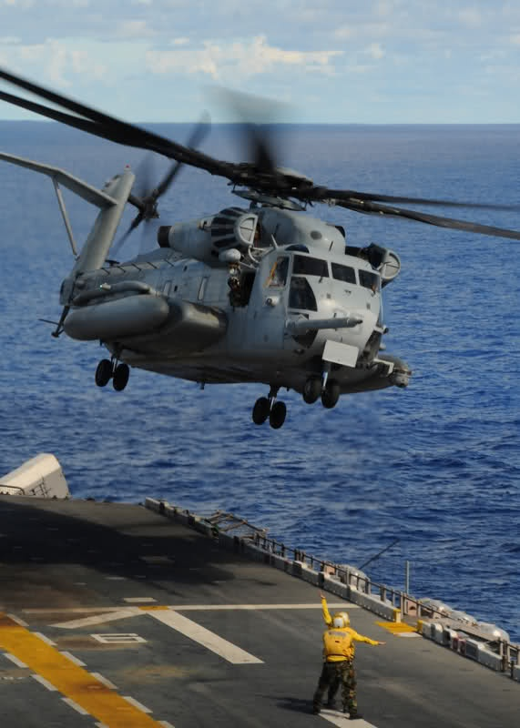 PHILIPPINE SEA (September 14, 2010) A CH-53E Sea Stallion helicopter, assigned to Marine Medium Helicopter Squadron Two Six Two (HMM-262), takes-off from the flight deck of the forward-deployed amphibious assault ship USS Essex (LHD 2). (U.S. Navy photo by Mass Communication Specialist 2nd Class Mark R. Alvarez/Released)