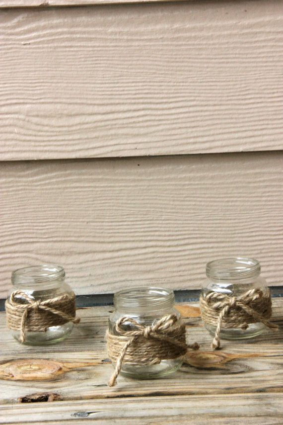These are small jars (baby food size) wrapped by hand in hemp and topped with a bow! These are perfect for any country or rustic themed wedding. A small candle fits perfectly inside.