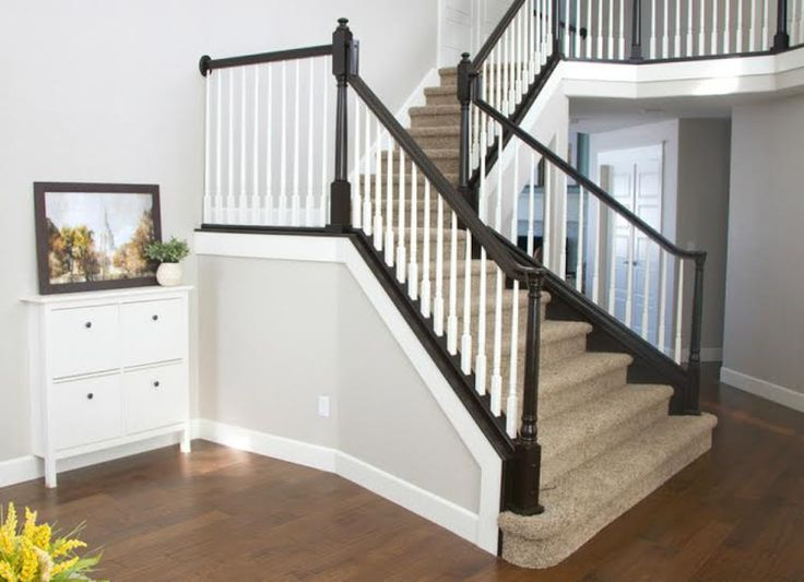 No sanding required. Simply apply a couple of coats of gel stain, then tape and paint the rest of the staircase.