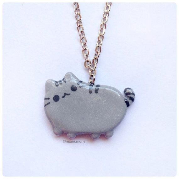 Pusheen Cat Necklace. .. @Jocelynn Lenz .. I found out fat kitty's name!! Search pusheen cat on here... Omg!