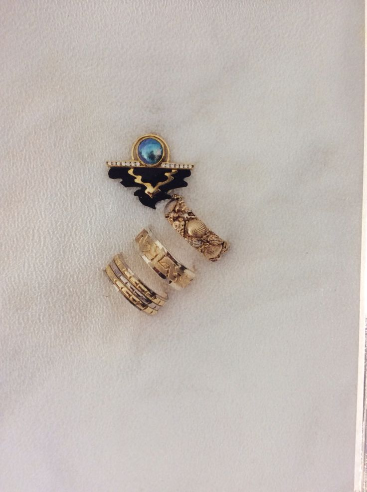 various sculptured gents wedding rings and Sunrise,a pendant featuring a pacific blue pearl onyx and diamond