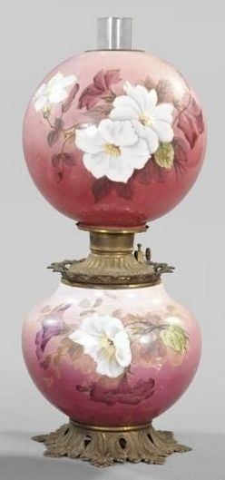 lighting, America, A white opal glass kerosene parlor lamp, fourth quarter 19th century, by F. G. Company, patinated brass-mounted floral-enameled lamp in Morning Glories decor, retaining the period burner, shade ring, blown glass chimney and spherical floral-enamedl white opal glass shade