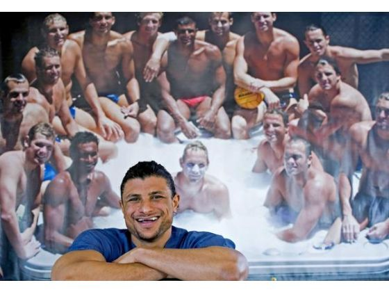 Omar Amr, in front of the photo of his Olympic teammates from 2004, is a UCI alumnus, former Olympic water polo player and now doctor, who juggled a cross ...
