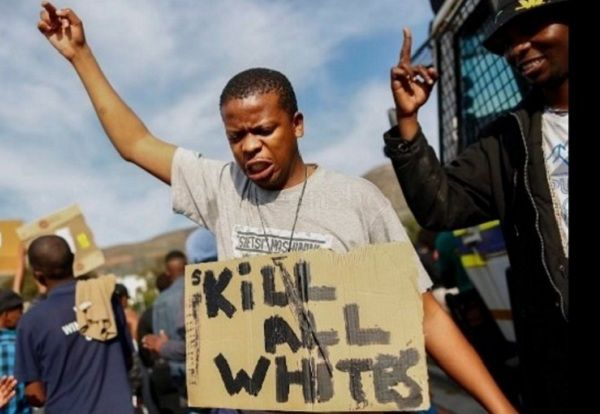 """Terrorist hate-group Black Lives Matter surrogates marches to the US Consulate with mass mobilisation. The march was in Khayelitsha. One black male displayed a hand-written poster calling to """"kill all whites""""!!"""