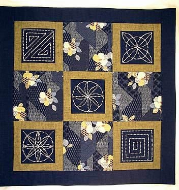 quilt with sashiko-embroidered blocks - it's on my list of new things to try!