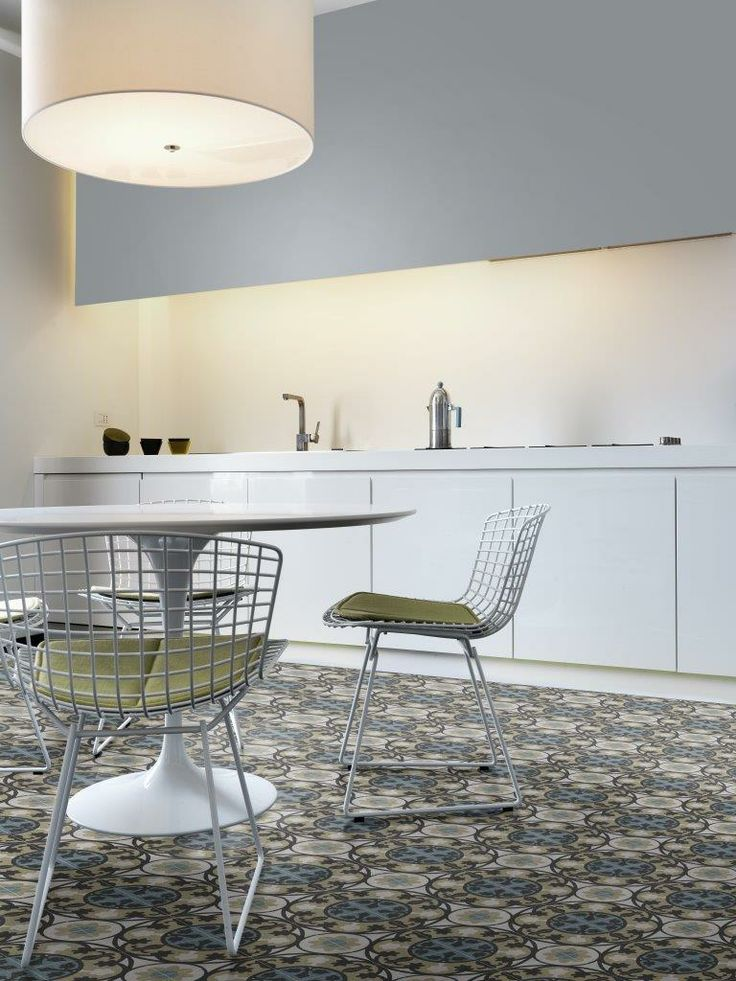 Simple kitchen and dining space taken to a new level by patterned terrazzo flooring. New range of terrazzo coming to Signorino Tile Gallery in early 2014.