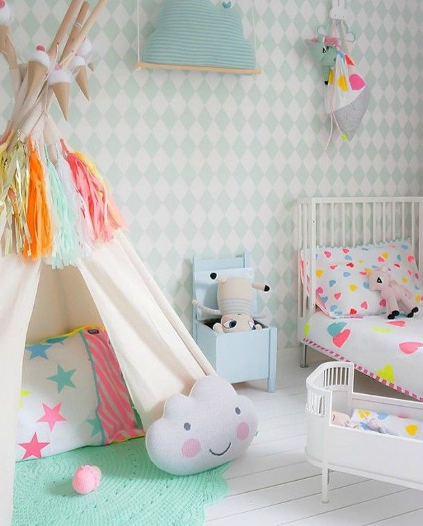 Mix sunny yellows, neon pink, and brilliant blue with its pastel counterparts to create a cute space. | A Neutral and Neon Nursery | Kids Design Life