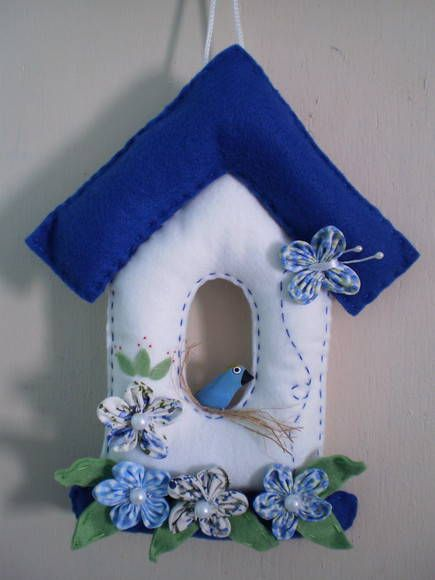 would work for layered card. Use butterfly punch and various flowers/leaves.white part of birdhouse/embossing folder.