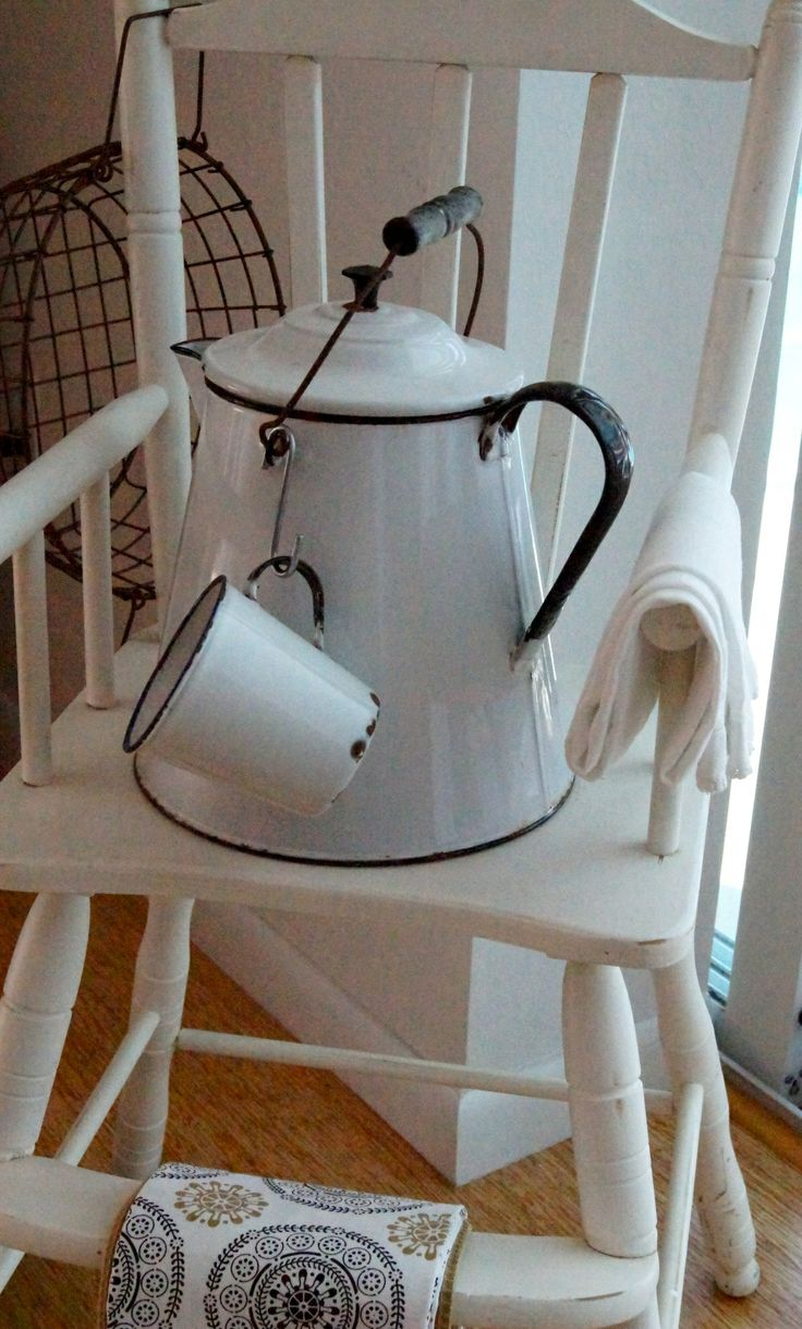 Vintage enamelware / and high chair -  photo by Dollye Dorris