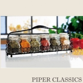 """This seven piecespice jar set can be neatly stored on your kitchen counter top, or easily moved to a more convenient spot. Each spice jar has an air tight hermetic seal to keep your favorite spices or herbs fresh, but is easy to open with a flip of the fingers and ready to dispense. Set does not include spices. Each jar holds 4 ounces (volume). Set measures 14"""" wide x 2.5"""" deep x 3.5"""" high."""