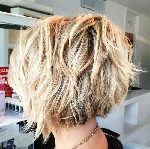 short shaggy brown blonde hairstyle. Love the back and then a few long pieces in…