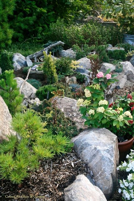 639 best rock garden ideas images on pinterest decks for Hillside rock garden designs