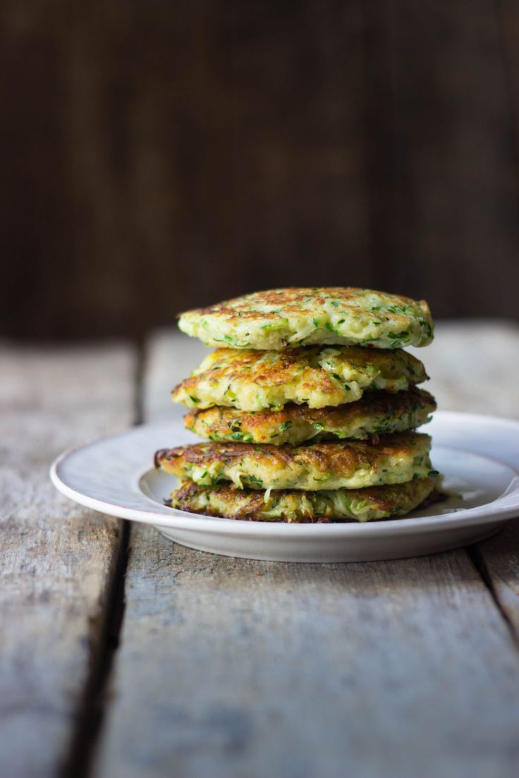 Crispy Zucchini Fritters: Simple pan-fried zucchini fritters with cheese, herbs and spices. Serve with spicy Sriracha ma…