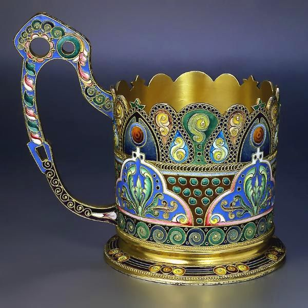 Gilded silver and shaded cloisonne enamel antique Russian tea glass holder by the 11th Artel, made in Moscow between 1908 and 1917, decorated in the Modern style of the 1910s.