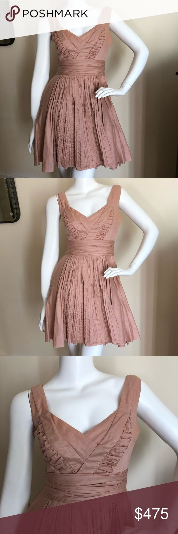 "Prada dusty rose cocktail dress Breathtaking authentic Prada dusty rose colored cocktail dress. Pleating throughout. Size 38 which is a US XS. Excellent condition!! Skirt has tulle under layers so it flows so nicely! Cotton. Length 31"" pit to pit 16"" waist flat across 13"". Prada Dresses"