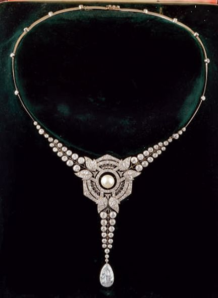 An important Art Deco necklace, by Maison Briquet, Place Vendôme. The necklace centring a fine pearl in a fine openwork geometrical Art Deco setting surrounded by brilliant-cut diamonds, suspending a pear-shaped diamond weighing 2.78 carats, mounted in white gold.