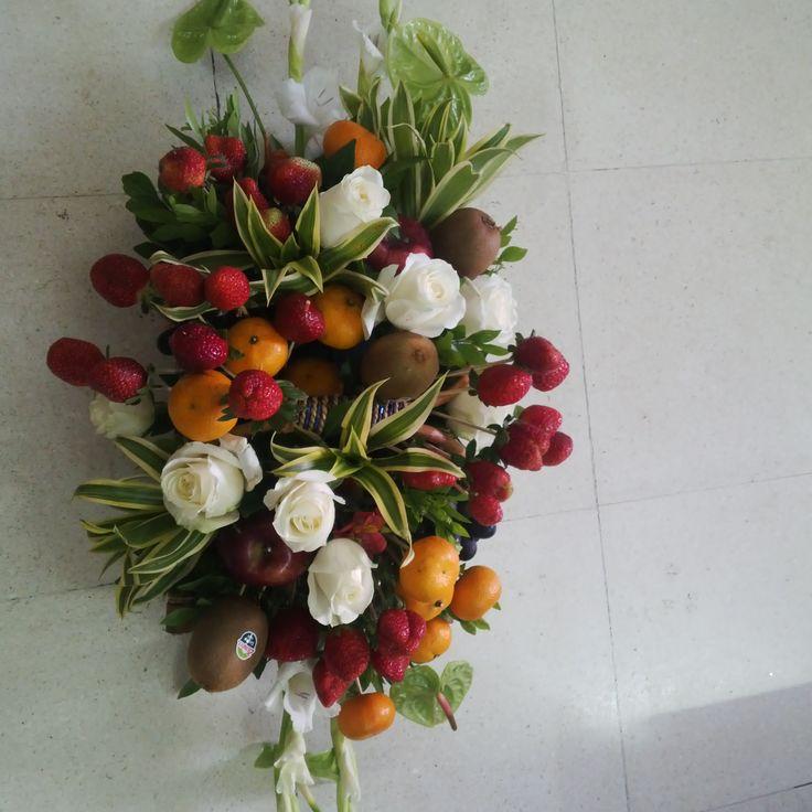 Fresh fruit and flower arrangement