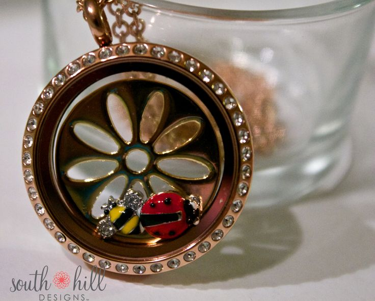 Large rose gold locket, gold sunflower screen, bumble bee and ladybug charms!